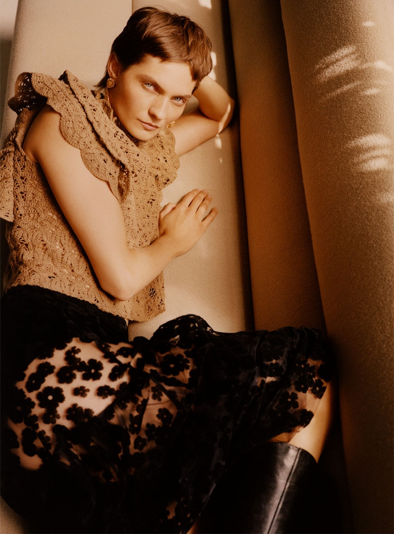 Karolin Wolter poses in Zara textured ruffled top, embroidered skirt and sparkly textured earrings