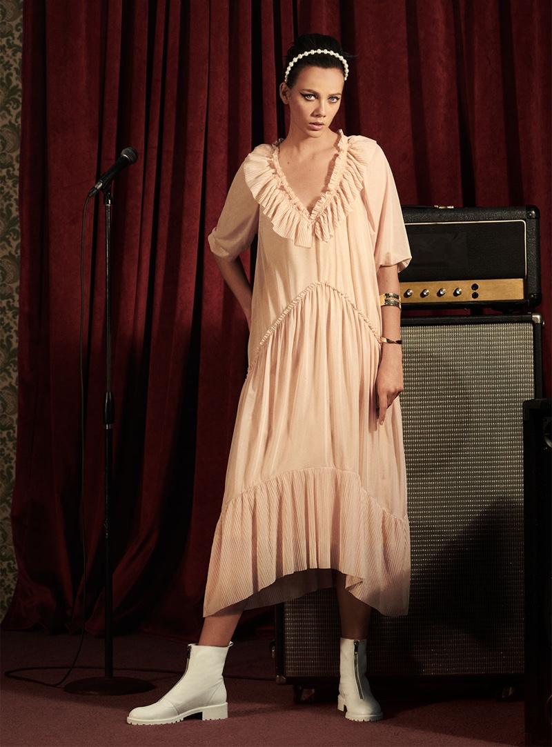 Model Marjan Jonkman wears Zara flowy dress, leather ankle boots with zipper and pearl headband