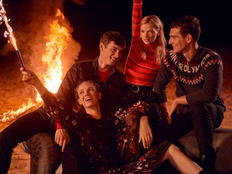 Models pose by a bonfire in Beymen fall-winter 2019 campaign