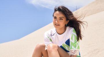 Posing in sand, Camila Mendes wears Koche dress and Argente Vivo earrings