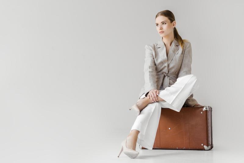 Chic Model Jacket Pants Sitting Suitcase