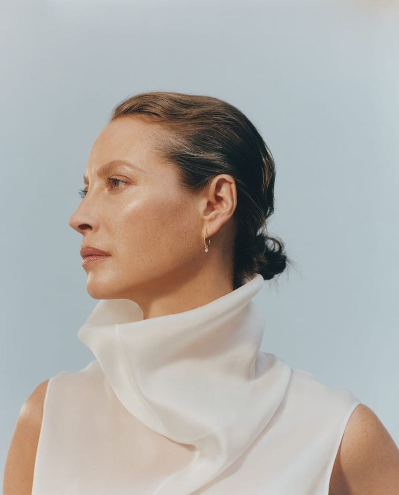 Christy Turlington poses in The Row top and Raphaele Canot earrings for MATCHESFASHION fall-winter 2019 campaign