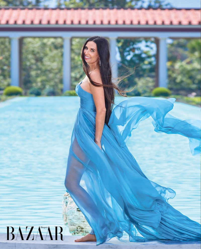 Dressed in blue, Demi Moore wears Valentino Haute Couture gown