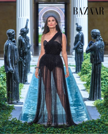 Actress Demi Moore wears Dior Haute Couture dress and Sergio Rossi sandals