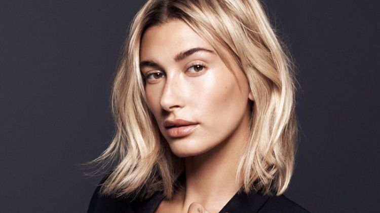 Model Hailey Baldwin appears in Daniel Wellington Iconic Link watch campaign