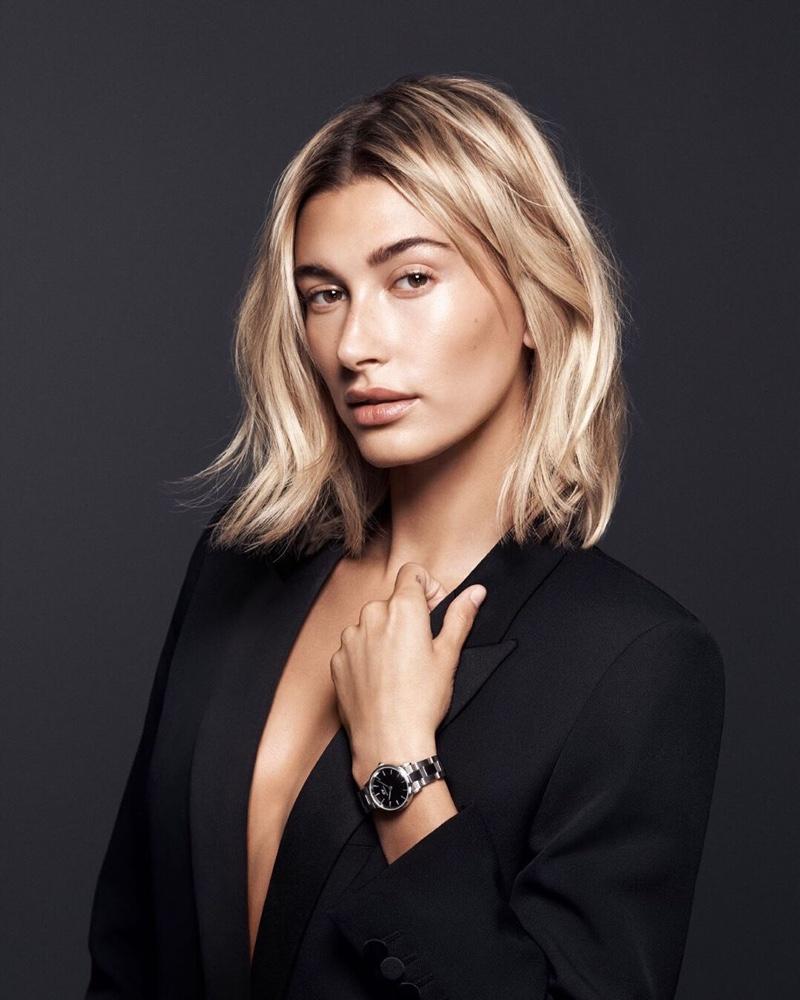 Model Hailey Baldwin appears in Daniel Wellington Iconic Link watch campaign