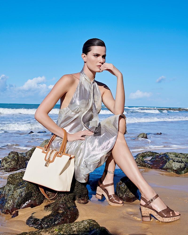 Wearing a silver dress, Isabeli Fontana fronts Luz da Lua summer 2020 campaign