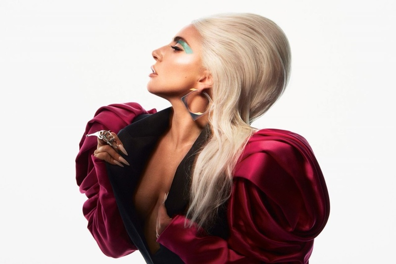 Striking a pose, Lady Gaga wears Alexander McQueen blazer and Rainbow Unicorn Birthday Surprise earring