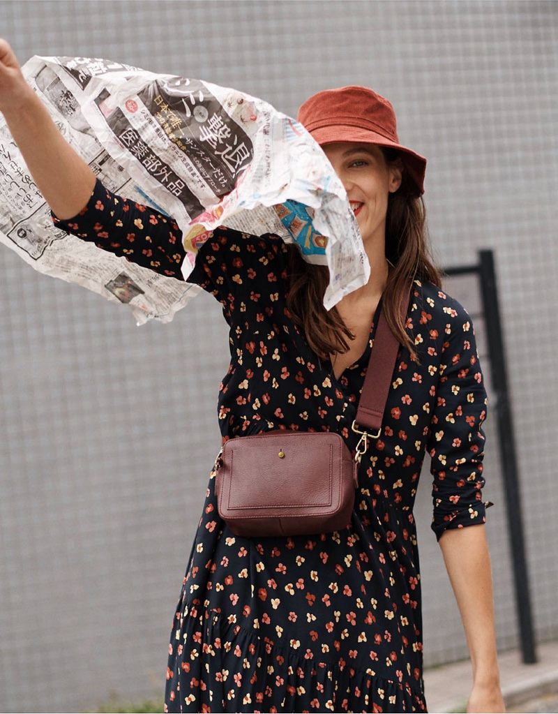 Madewell Button-Front Tier Midi Dress in Feline Floral $138, Short-Brimmed Corduroy Bucket Hat $32 and The Transport Camera Bag $128