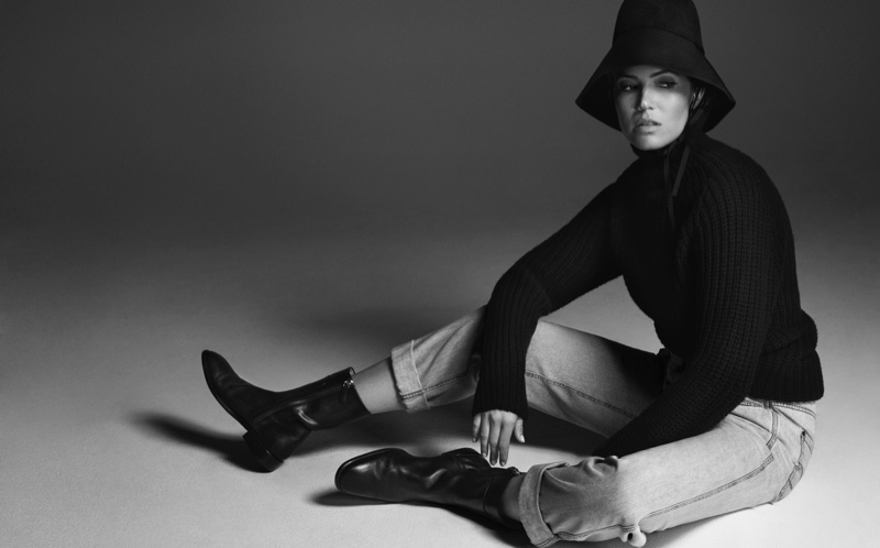 Captured in black and white, Mandy Moore wears Valentino hat, Officine Generale sweater, Brunello Cucinelli pants and Salvatore Ferragamo boots