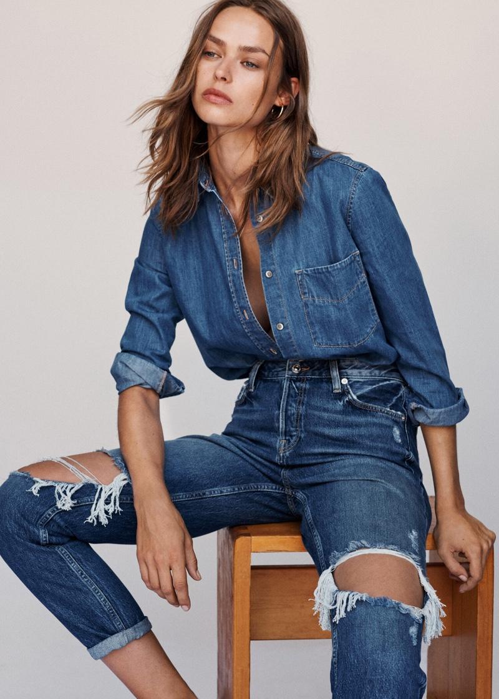 Model Birgit Kos poses in double denim for Mango
