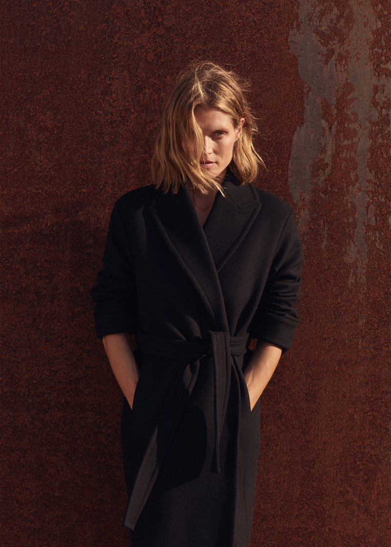 Malgosia Bela poses in Mango belted wool coat