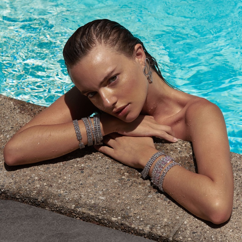 Posing in a pool, Maya Stepper fronts Fallon Jewelry campaign