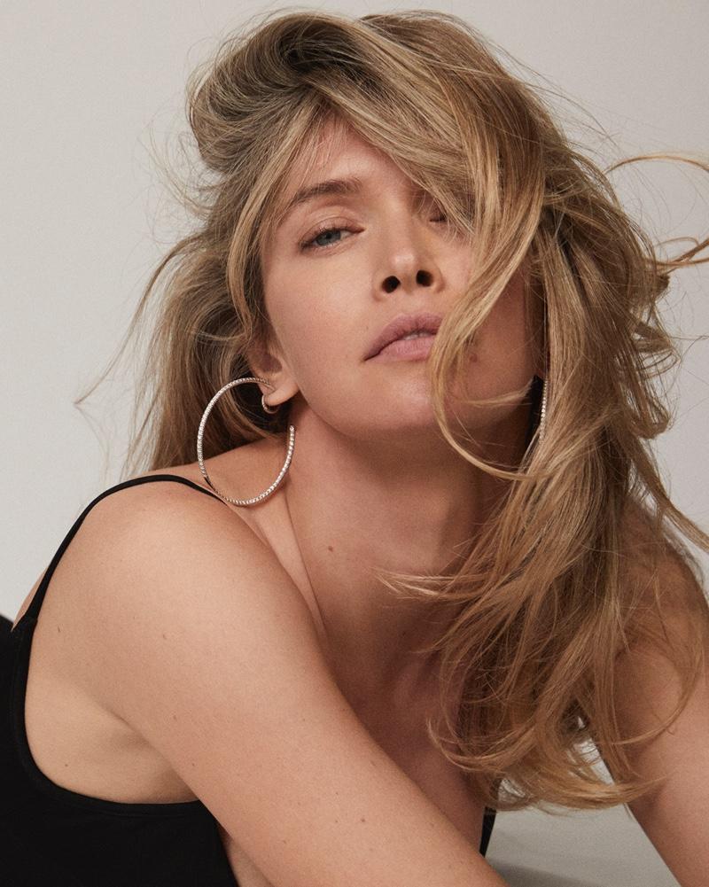 Getting her closeup, Vera Brezhneva wears hoop earrings