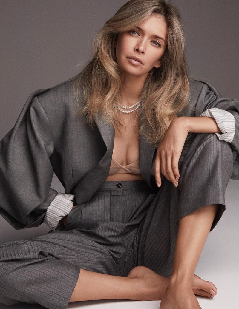 Suiting up, Vera Brezhneva strikes a pose