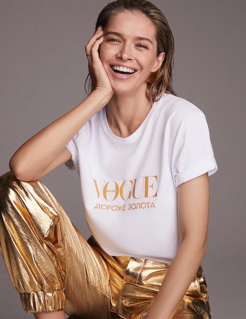 Singer Vera Brezhneva wears a Vogue shirt with gold pants