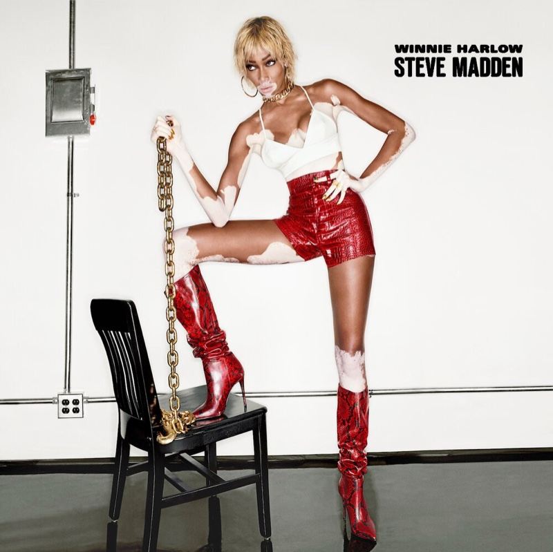 Looking red-hot, Winnie Harlow wears snakeskin print boots from Steve Madden collaboration