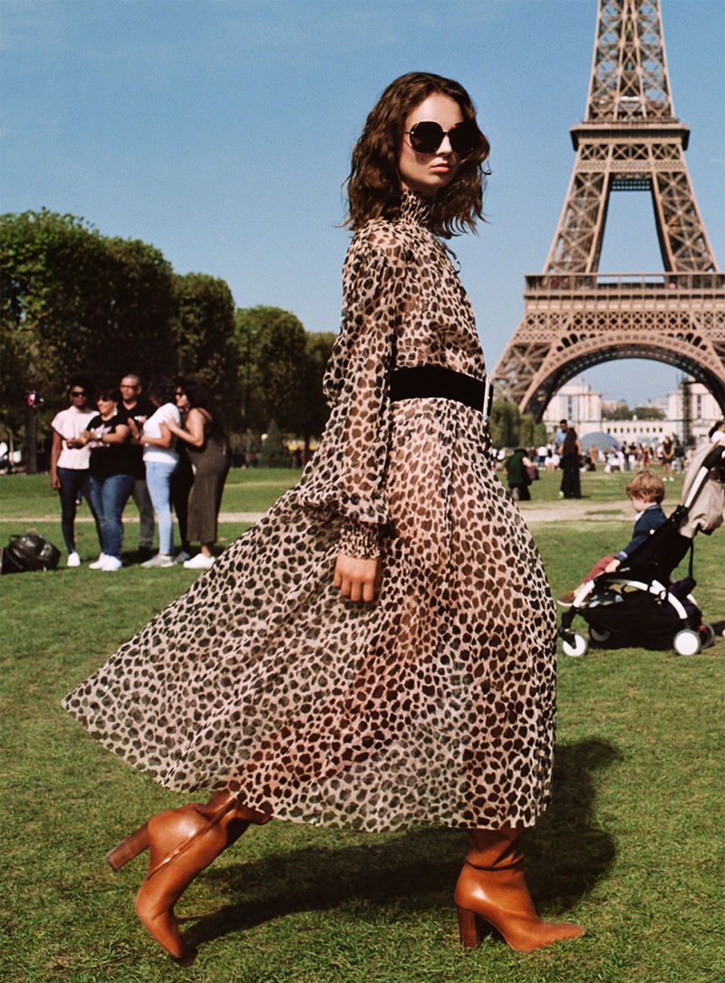 Giselle Norman models Zara animal print dress, over the knee leather boots and tortoiseshell sunglasses