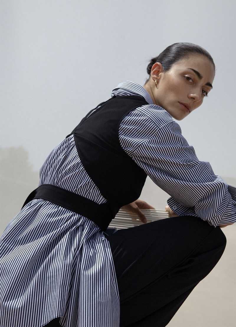 Conie Vallese wears Zara crop top with cut-out detail, striped shirt with asymmetric neckline and wide leg pants with darts