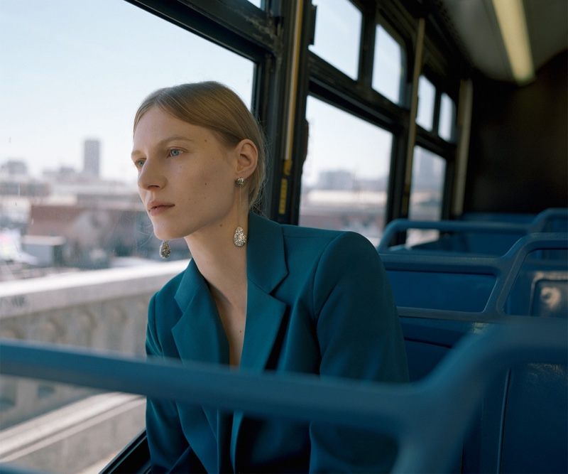 Julia Nobis wears Zara turquoise blazer and diamante earrings