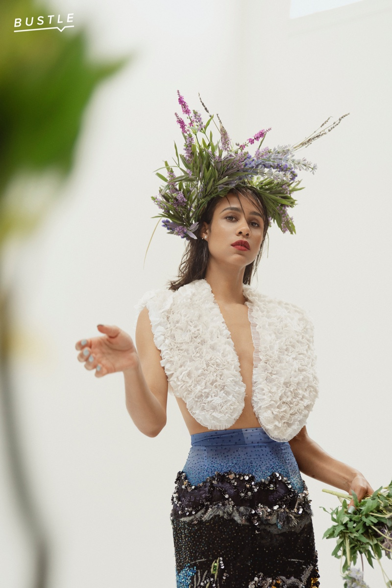 Posing for Bustle, Zawe Ashton wears Mary Katrantzou top, skirt and Pamela Love earrings