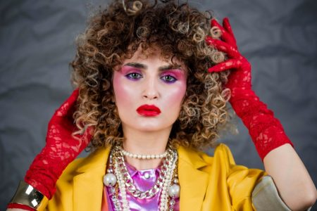 Big curly hair is a popular look from the 1980s.