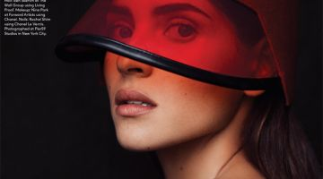 Ready for her closeup, Adria Arjona wears Gucci visor with Cartier rings