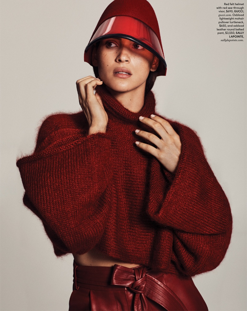 Adria Arjona poses in Gucci visor with Sally LaPointe sweater and trousers
