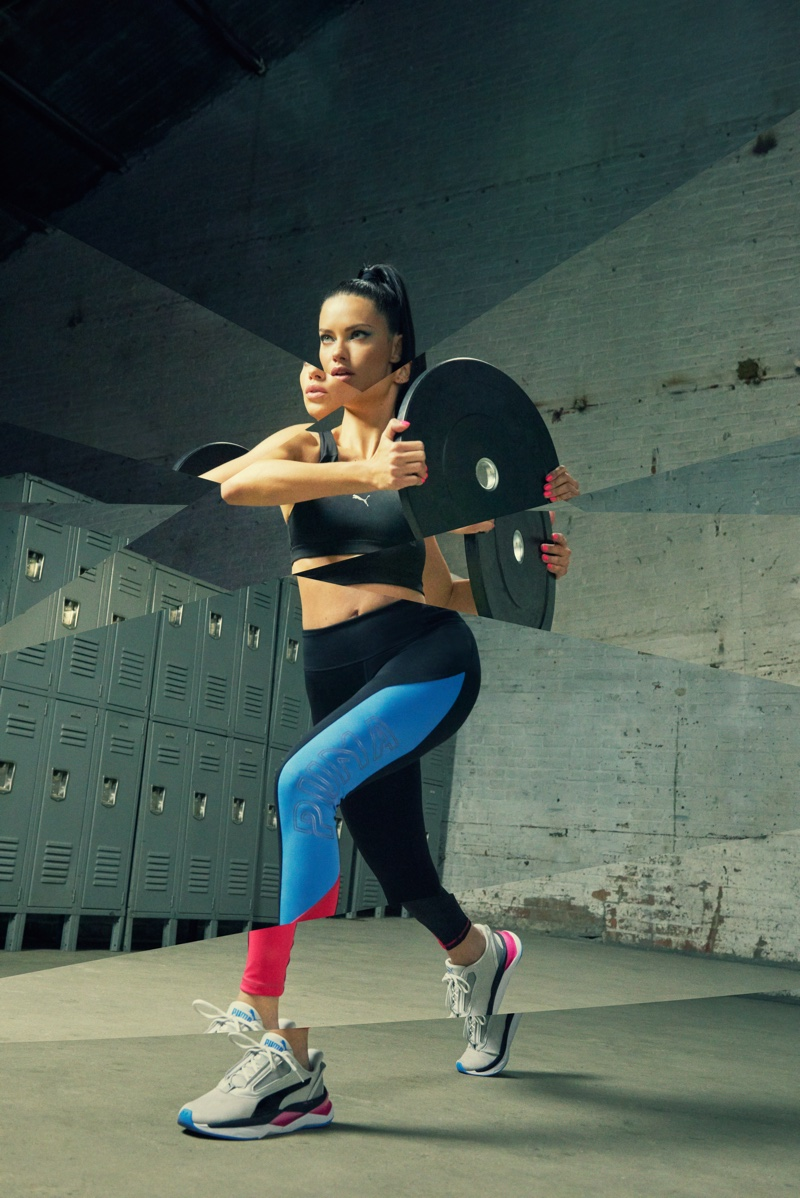 Adriana Lima does a lunge in PUMA LQD CELL Shatter XT Shift sneaker campaign