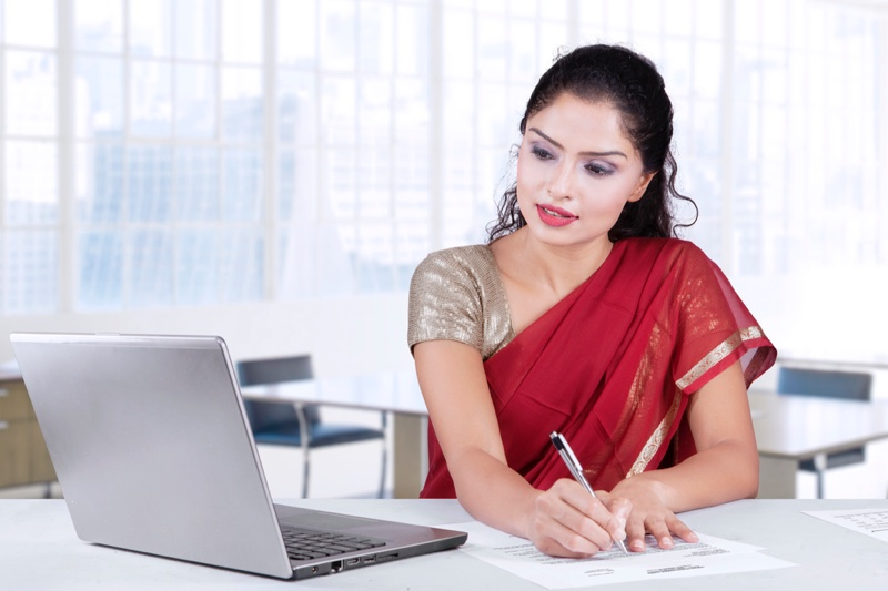 Attractive Indian Woman Office Saree Laptop Desk