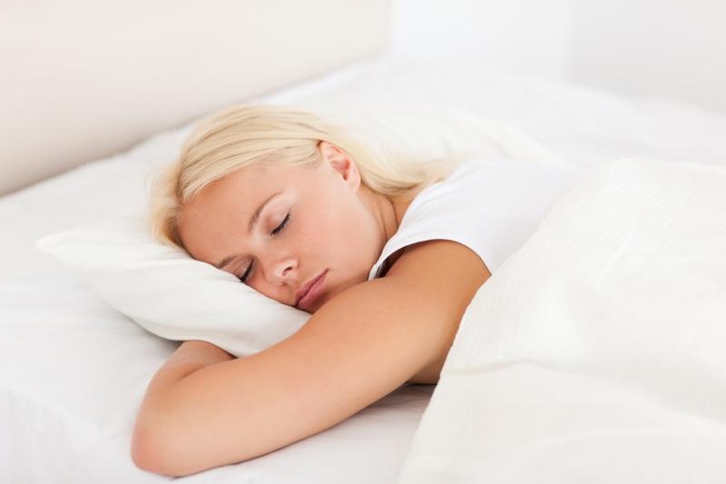 Blonde Model Sleeping Bed