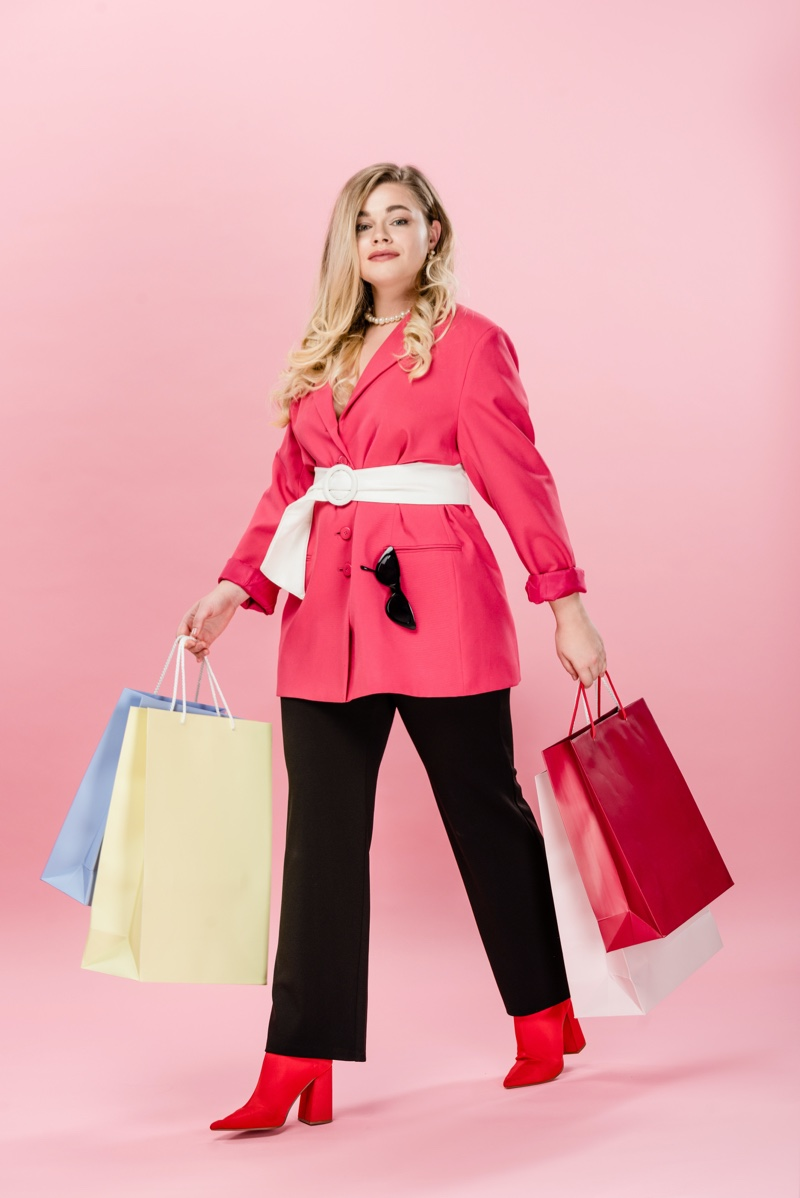Blonde Plus Size Woman Shopping Bags Jacket Pants
