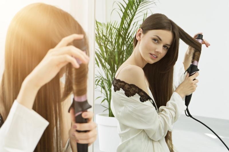 Brunette Model Using Hair Curler Mirror