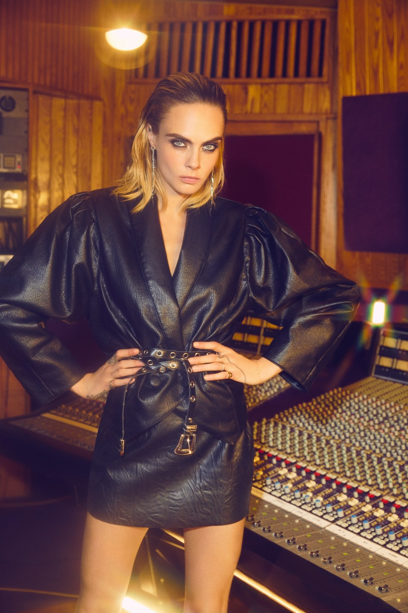 Model Cara Delevingne sports faux leather for Nasty Gal collection