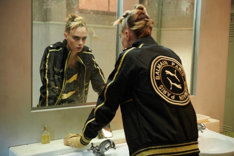 Looking in a mirror, Cara Delevingne fronts PUMA x Balmain campaign