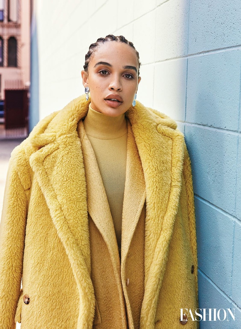 Looking mellow in yellow, Cleopatra Coleman wears Max Mara coat, jacket and turtleneck with Jenny Bird earrings