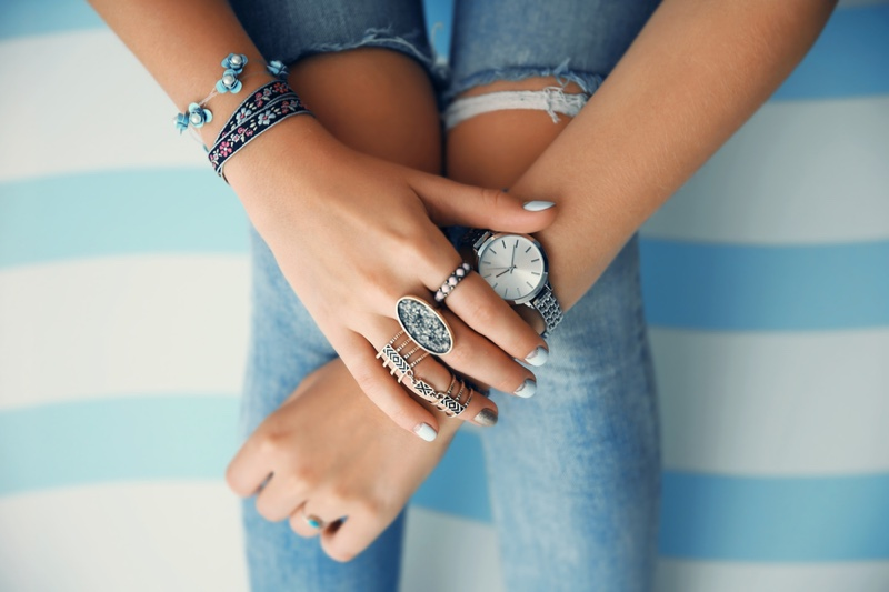Closeup Fashion Jewelry Hand Watch Jeans Ripped