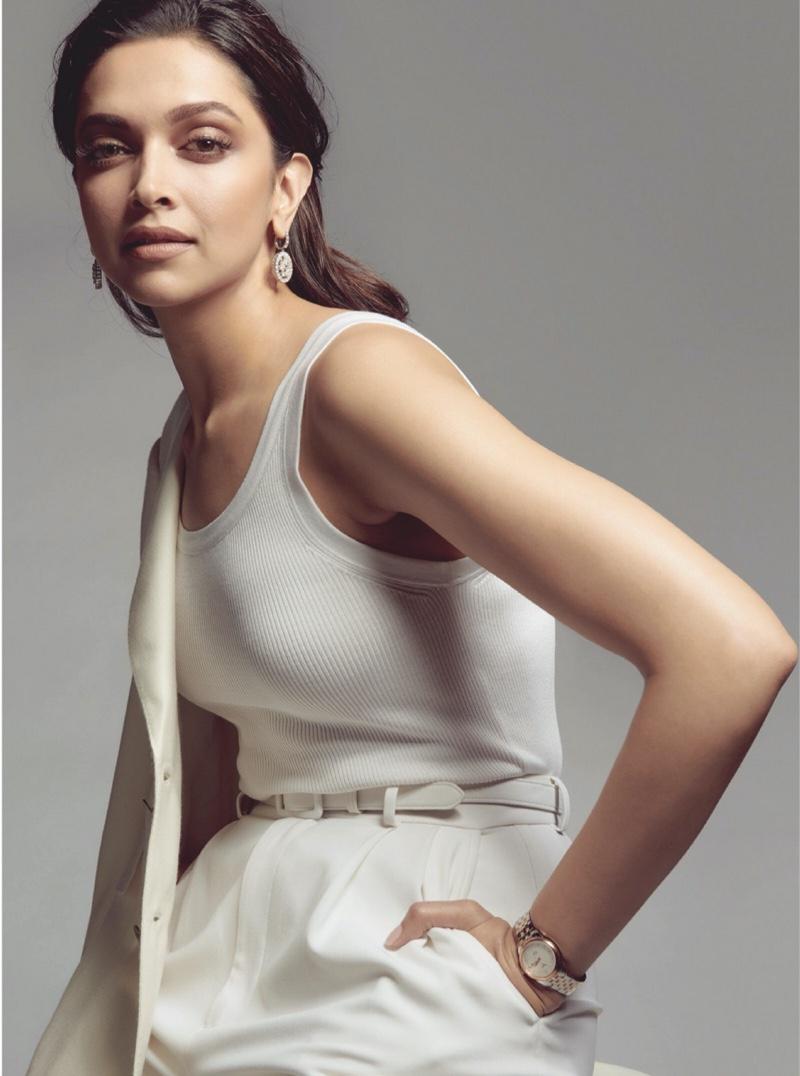 Dressed in white, Deepika Padukone wears Ralph Lauren top, pants, blazer and belt