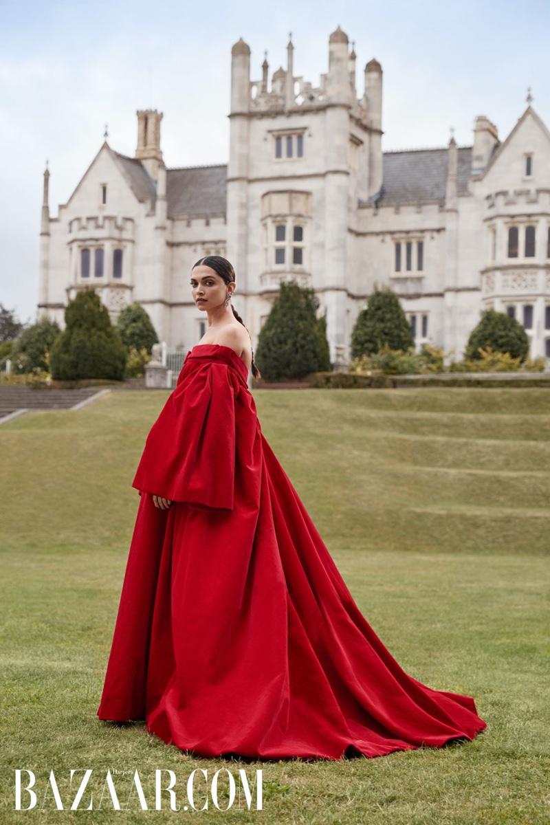 Looking striking in red, Deepika Padukone models Emilia Wickstead gown