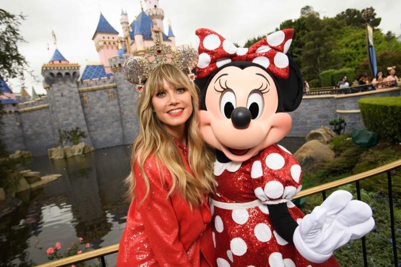 Heidi Klum poses with Minnie Mouse at Disneyland.