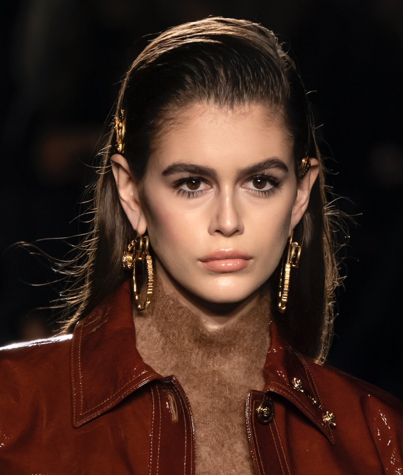 Model Kaia Gerber wears a sleek chestnut brown hair color.
