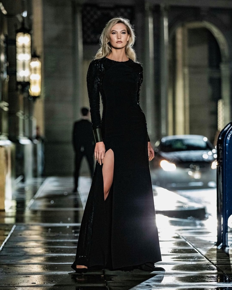 Supermodel Karlie Kloss wears a black gown for Carolina Herrera Bad Boy promotional shots