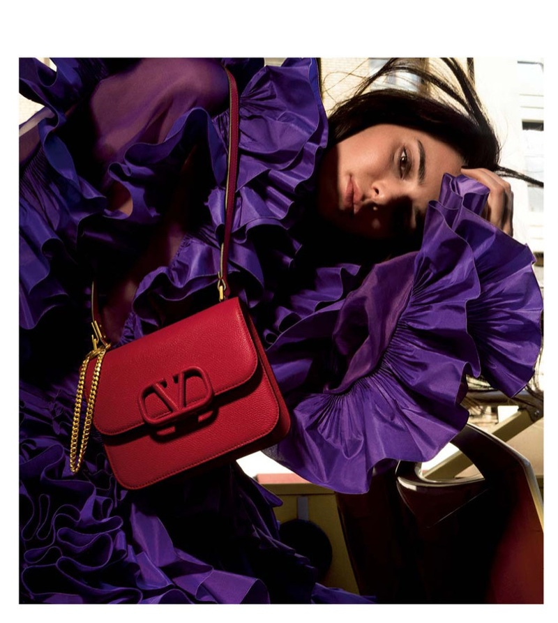 Model Kendall Jenner poses with VSLING bag in Valentino resort 2020 accessories campaign