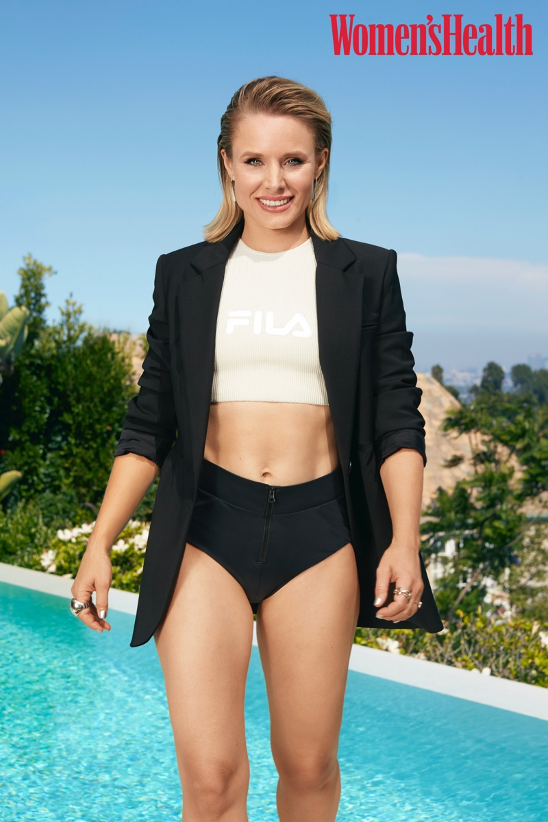 Actress Kristen Bell poses in Wilfred for Aritzia blazer, Haight x Fila top and adidas x Stella McCartney shorts