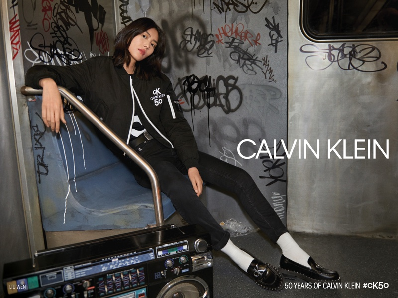 Posing on the subway, Liu Wen fronts Calvin Klein #CK50 campaign