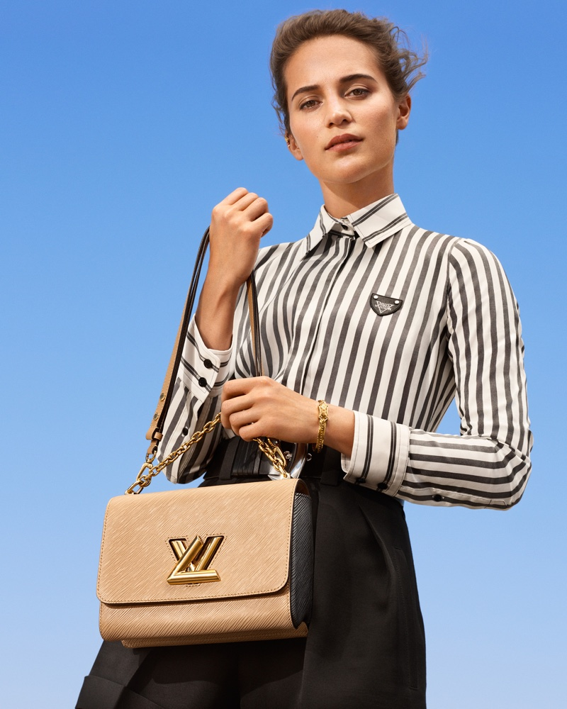 Actress Alicia Vikander poses with Twist MM bag for Louis Vuitton New Classics campaign
