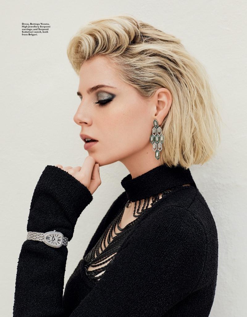 Actress Lucy Boynton wears Bottega Veneta dress with Bulgari earrings and watch
