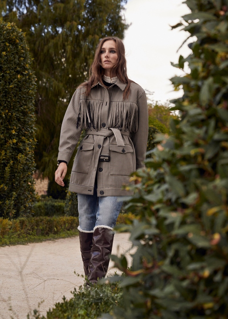 Josephine le Tutour poses in Mango Prince of Wales trench coat