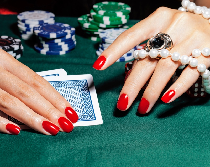 Manicured Red Nails Card Chips Gambling