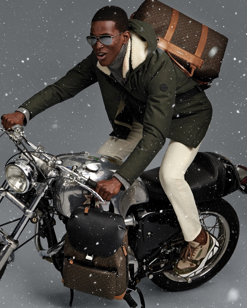 Salomon Diaz rides a motorcycle in Michael Kors Mens holiday 2019 campaign